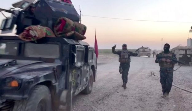 This image made from a video shows Iraqi soldiers and military vehicles in the Qatash area towards Kirkuk gas plant, south of Kirkuk, Iraq on Monday October 16, 2017.