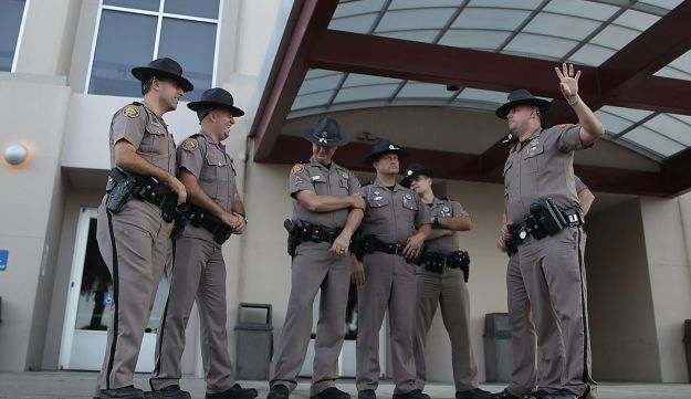 Florida Highway Patrol officers stand outside the Curtis M. Phillips Center for the Performing Arts ahead of Thursday's scheduled speech by white nationalist Richard Spencer on October 18, 2017 in Gainesville, Florida