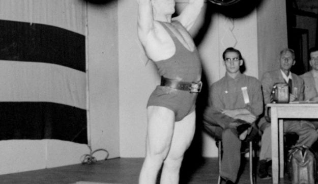 Isaac Berger presses 220 pounds at the U.S. Olympic trials weight lifting meet in San Jose, California October 28, 1956. Berger went on to win the gold medal the following month at the 1956 Melbourne Olympics.