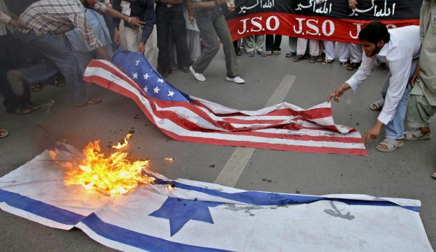 Pakistani Shiite Muslim group burn the U. S. and Israeli flags in Islamabad, Pakistan to show their support for Iran and Palestine. June 18, 2006