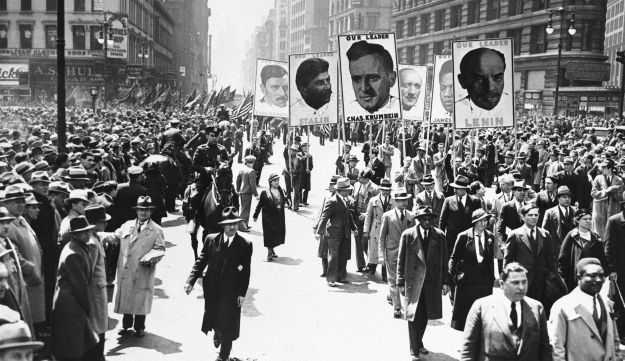 Somewhere between 40,000 to 60,000 Communists (not including the socialist paraders) carrying likenesses of Lenin, Stalin, Krumbein, and others, march in New York City, May 1, 1935 to celebrate the International Workers' holiday.