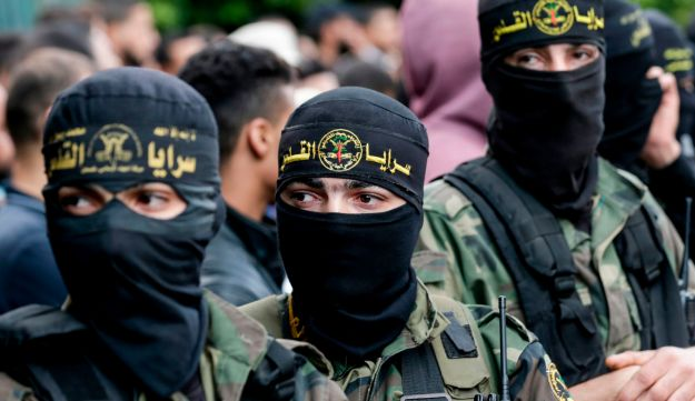 Fighters from the Islamic Jihad Movement in Palestine attend the funeral of comrades killed in an Israeli operation to blow up a tunnel stretching from the Gaza Strip into Israel during their funeral at the Bureij refugee camp, in central Gaza, on October 31, 2017.  Tensions rose after an Israeli operation to blow up a tunnel from the Gaza Strip killed seven Palestinian militants in one of the deadliest incidents since a devastating 2014 war.