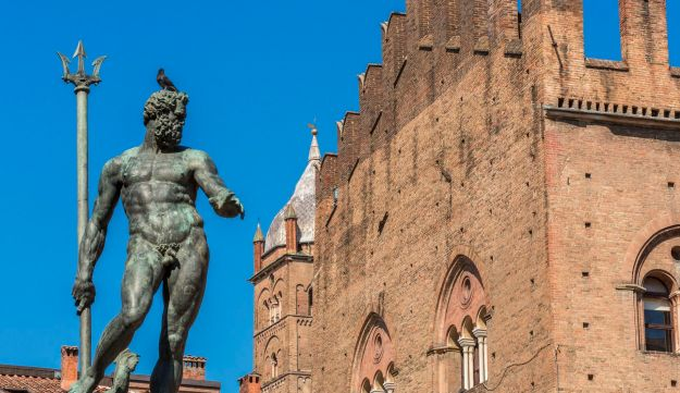 Scenes from medieval Bologna: The 16th century Fountain of Neptune with the 13th century Palazzo Re Enzo in the background.