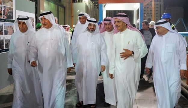Bakr Binladin, second from right, and Saudi Arabia's then-finance minister, second from left, visit a construction project in Medina, Saudi Arabia, July 23, 2014.