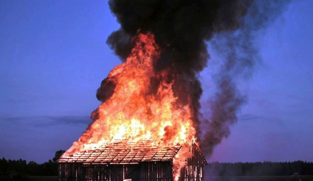Polish performance artist Rafal Betlejemski burns down a barn in central Poland to commemorate the  1941 Jedwabne pogrom in which more than 300 Jews were locked in a barn and burned alive. July 11, 2010