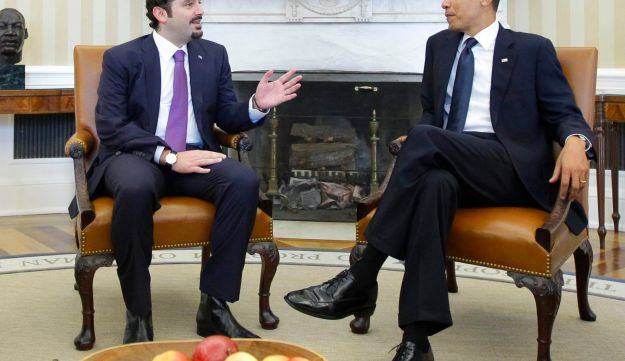 FILE - In this Jan. 12, 2011 file photo, President Barack Obama meets with Lebanese Prime Minister Saad Hariri, in the Oval Office of the White House in Washington. Hariri who resigned from Saudi Arabia nearly two weeks ago has been caught in the crossfire between the regionג€™s two feuding powers -- Sunni Saudi Arabia and Shiite Iran. The 47-year-old who for years had tried to play a balancing act in Lebanon, with its delicate, sectarian-based political system, resigned in the most bizarre manner, throwing the countryג€™s and his own political future into the unknown. (AP Photo/Charles Dharapak, File)