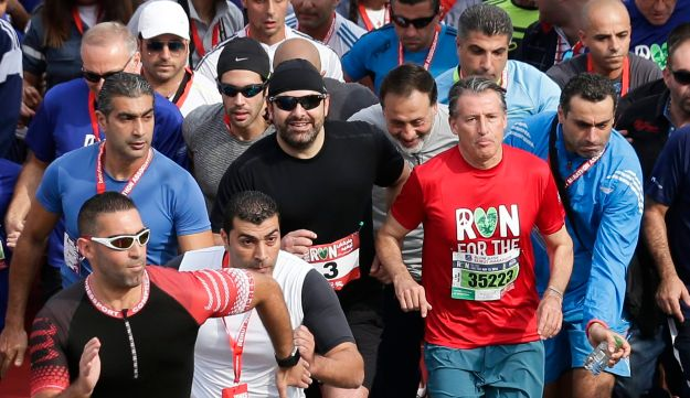 FILE - In this Nov. 13, 2016 file photo, then Lebanese Prime Minister designate, Saad Hariri, wearing number 3 runs in the 7K Fun Run of the Beirut marathon, Lebanon. Hariri who resigned from Saudi Arabia nearly two weeks ago has been caught in the crossfire between the regionג€™s two feuding powers -- Sunni Saudi Arabia and Shiite Iran. The 47-year-old who for years had tried to play a balancing act in Lebanon, with its delicate, sectarian-based political system, resigned in the most bizarre manner, throwing the countryג€™s and his own political future into the unknown. (AP Photo/Hassan Ammar, File)