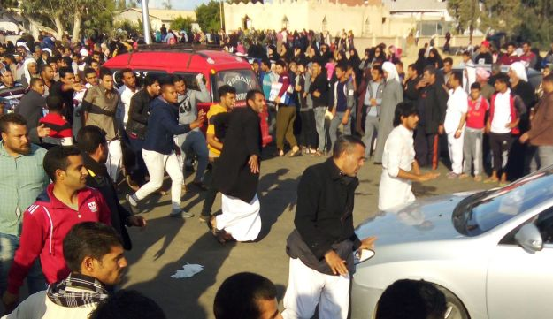 Egyptians gather at the site of a gun and bombing attack that targeted the Rawda mosque near North Sinai provincial capital of El-Arish on November 24, 2017.
