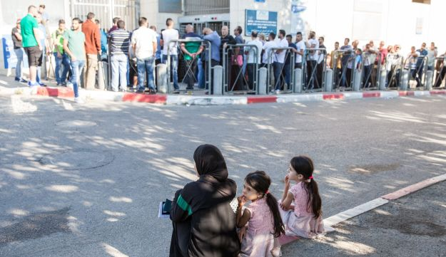 Palestinians waiting outside the Interior Ministry in East Jerusalem, May 2017.