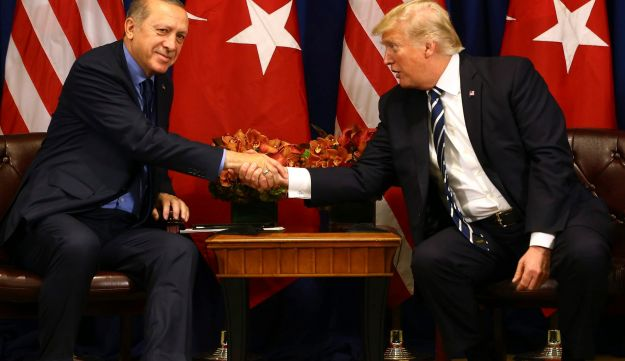 FILE PHOTO: Turkey's President Tayyip Erdogan and US President Donald Trump shake hands prior to meeting in New York on Thursday, Sept. 21, 2017.