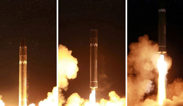 Photo released by North Korea's official Korean Central News Agency (KCNA) shows launching of the Hwasong-15 missile, capable of reaching all parts of the U.S.