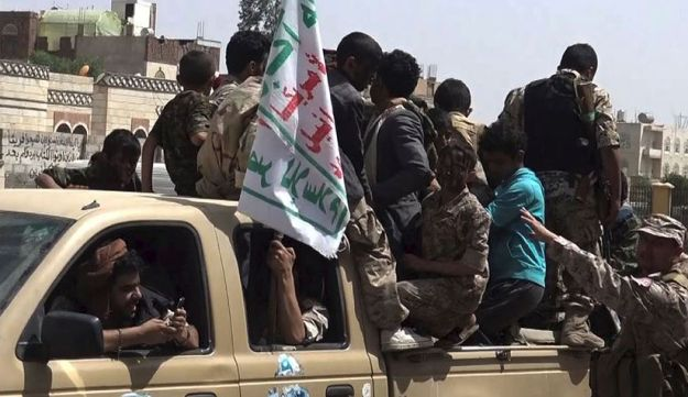 An image grab taken from AFP TV on December 2, 2017 shows Huthi rebel fighters riding on the back of a pickup truck and flying the group's flag, in the capital Sanaa