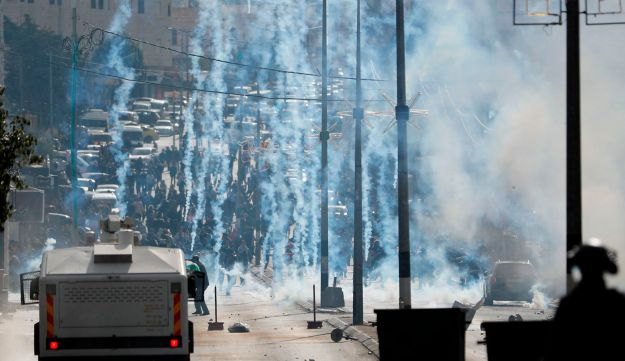 Israeli forces clash with Palestinian protesters near an Israeli checkpoint in the West Bank city of Bethlehem on December 7, 2017.