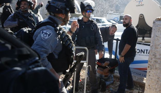 Israeli security forces detain a Palestinian man, December 8, 2017.