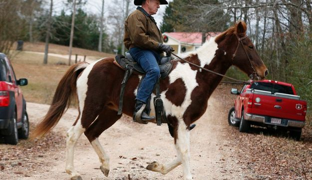 U.S. Senate Republican candidate Roy Moore rides a horse to vote, Tuesday, Dec. 12, 2017
