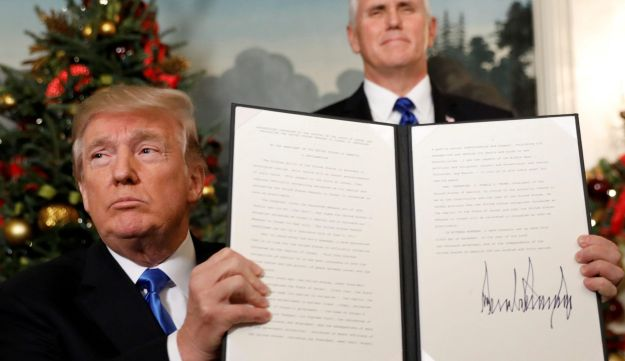 U.S. Vice President Mike Pence standing behind President Donald Trump after the U.S. recognition of Jerusalem as the Israeli capital, December 6, 2017.