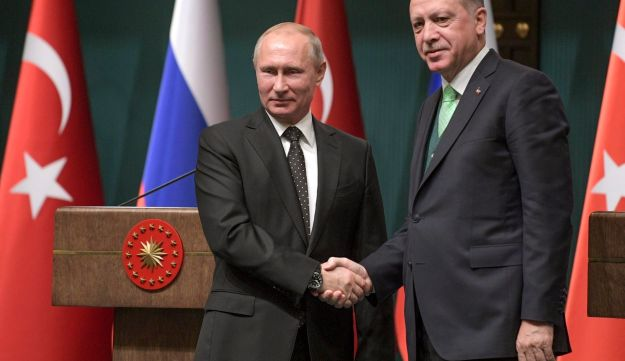 Turkey's President Recep Tayyip Erdogan, right, shakes hands with Russia's President Vladimir Putin, left, following their joint news statement after their meeting at the Presidential Palace in Ankara, Monday, Dec. 11, 2017. The two men met Monday evening to discuss developments in Syria and the Middle East, as well as bilateral relations, according to the Turkish President's office.