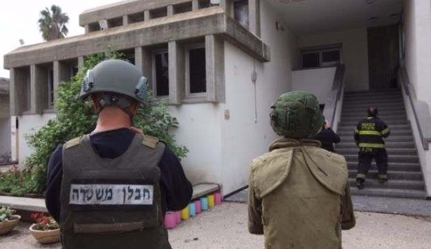 Israeli forces inspect a building that was damaged when a rocket fired from Gaza hit the Israeli regional council of Shaar Hanegev, December 29, 2017.
