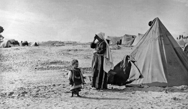 UNRWA Refugees in front of tent