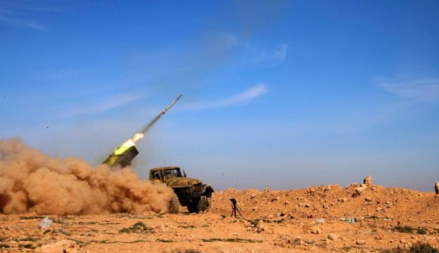 Syrian army fires a rocket at Islamic State group positions in the province of Raqqa, Syria, Wednesday, Feb. 17, 2016.