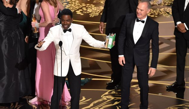 Host Chris Rock (L) and actor Michael Keaton celebrate onstage during the 88th Annual Academy Awards at the Dolby Theatre on February 28, 2016 in Hollywood, California.