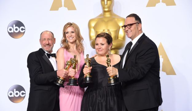 Producers Steve Golin, Nicole Rocklin, Blye Pagon Faust, and Michael Sugar, winners of Best Picture for 'Spotlight,' pose in the press room during the 88th Annual Academy Awards at Loews Hollywood Hotel on February 28, 2016 in Hollywood, California.
