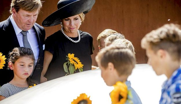 Dutch King Willem-Alexander (L) and Queen Maxima (C) attend the unveiling of the National Monument for the MH17 victims in Vijfhuizen on July 17, 2017