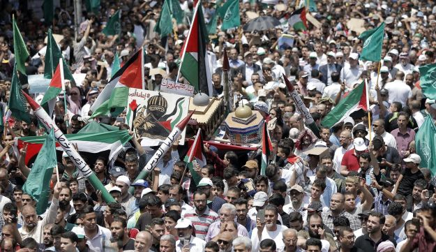 Jordanians carry a model of the Dome of the Rock mosque during a demonstration, called for by the Islamic Action Front, in Amman following Friday prayers on July 21, 2017