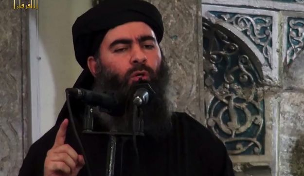A screenshot from an ISIS propaganda video allegedly shows ISIS leader Abu Bakr al-Baghdadi, speaking at a mosque in Mosul, Iraq.