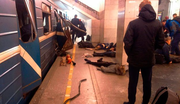 Blast victims lie near a subway train hit by a explosion at a metro station in St. Petersburg, Russia, April 3, 2017.