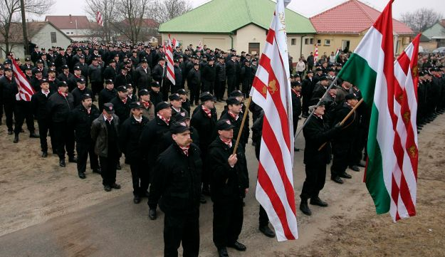 Members of right-wing group Hungarian Guard attend a rally protesting against what they said were crimes committed in the village by the local Roma in Tatarszentgyorgy, 60 km (37 miles) south of Budapest December 9, 2007.
