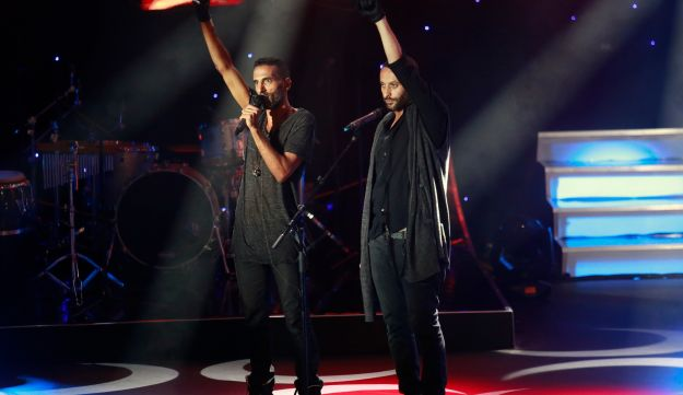 "Jewish performer Yossi Zabari and Tamer Nafar, the Arab star of the Israeli film ""Junction 48,"" raise their fist in a sign of protest during Ophir Awards. September 22, 2016."
