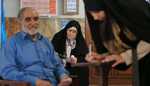 Iranian voters fill in their ballots for the presidential and municipal council election in Tehran, May 19, 2017.