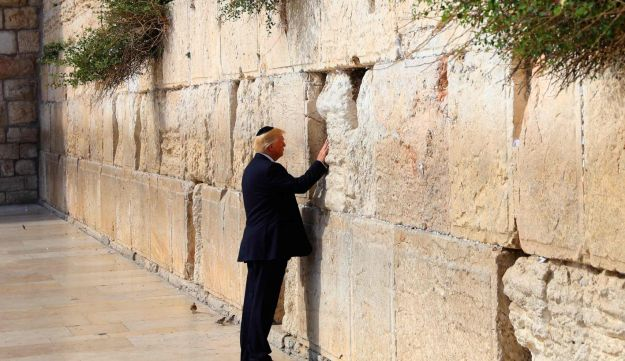 U.S. President Donald Trump places a note in a gap in the Western Wall in Jerusalem's Old City, May 22, 2017.