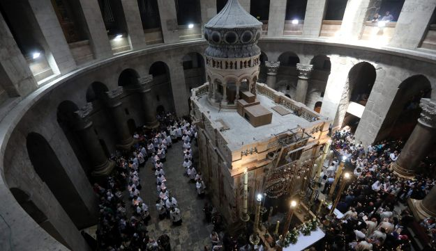Christian worshippers take part in a Sunday Easter mass procession in the Church of the Holy Sepulchre in Jerusalem's Old City, April 16, 2017.