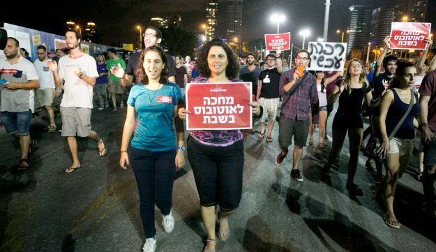 "A protest in Tel Aviv against the lack of public transport on the Jewish Sabbath, September 3, 2016. The main placard says, ""Waiting for a bus for Shabbat."""