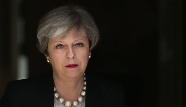 Britain's Prime Minister Theresa May walks to deliver a statement outside 10 Downing Street in central London on May 23, 2017 after a suspected suicide bombing in the northern city of Manchester.