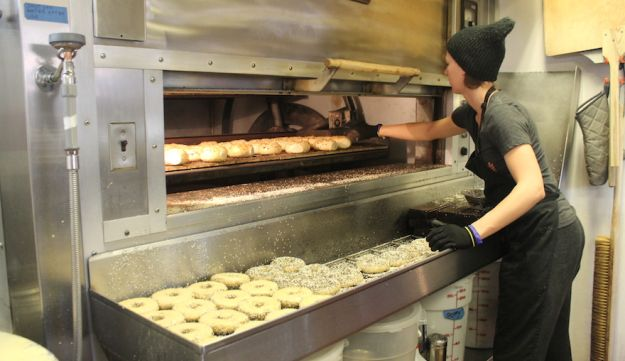 A worker in at The Bagel Project.