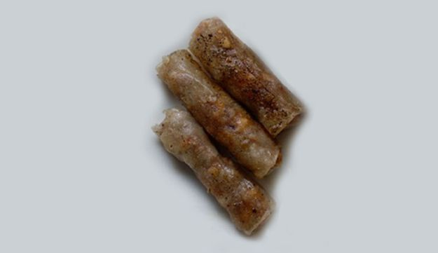 Marzipan and roasted nut cigars in rice paper (gluten free).