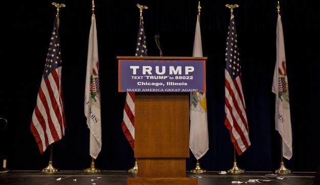 An empty podium stands on stage during a canceled campaign event with Donald Trump at the University of Illinois at Chicago Pavilion in Chicago, Illinois, U.S., on Friday, March 11, 2016.