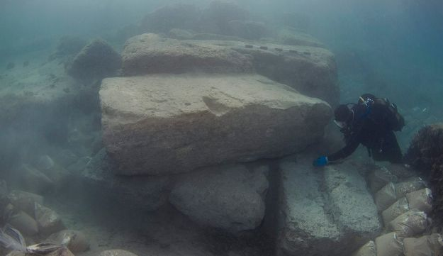 Maritime archaeologist investigating huge building stones at the outer part of the entrance canal to the Corinthian port of Lechaion.