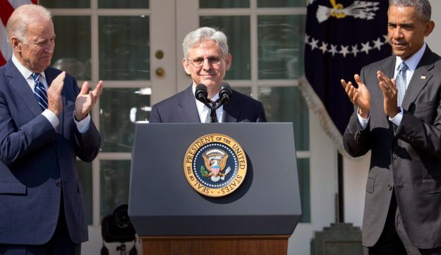 Judge Merrick Garland receives applauds from President Barack Obama and Vice President Joe Biden as he is introduced as Obama's nominee for the Supreme Court, Washington, Wednesday, March 16, 2016.