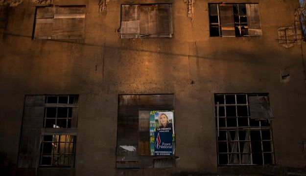 A poster showing Marine Le Pen on the wall of an abandoned factory on the outskirts of Hayange, France, April 3, 2017.