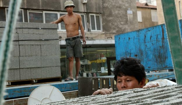 Chinese workers at a Tel Aviv construction site.