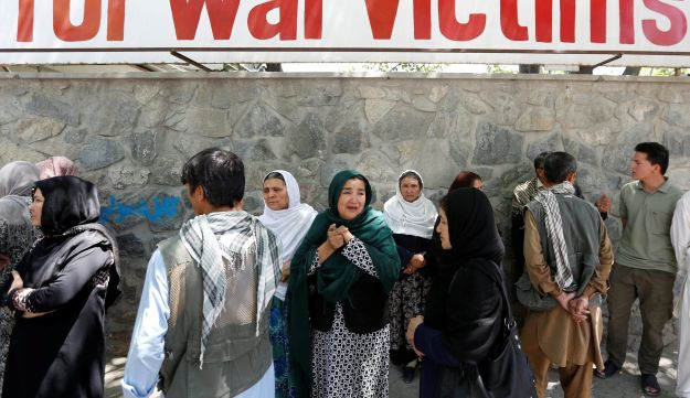 Afghan women mourn outside a hospital after a blast in Kabul, Afghanistan, May 31, 2017.