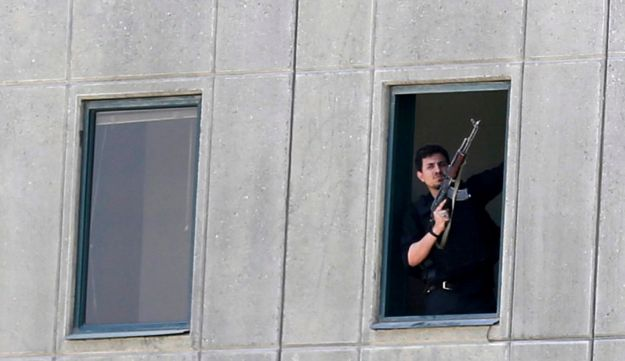 An Iranian policeman looks out of the parliament's building in central Tehran, Iran, June 7, 2017.