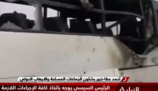 An image grab taken from Egypt's state-run Nile News TV channel shows the remains of a bus that was attacked while carrying Egyptian Christians in Minya province, May 26, 2017.