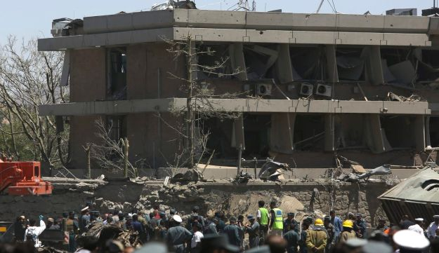 Afghan officials inspect outside the German embassy after a blast in Kabul, Afghanistan May 31, 2017.