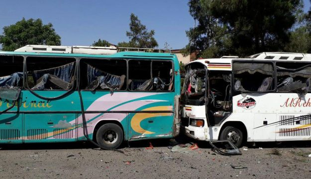 Damaged buses are pictured at one of the blast sites in Damascus in this handout picture posted on SANA on July 2, 2017, Syria.