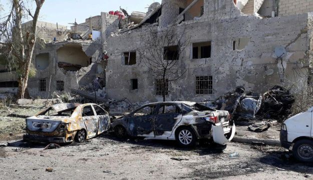 Damaged cars are seen at one of the blast sites in Damascus in this handout picture posted on SANA on July 2, 2017, Syria.